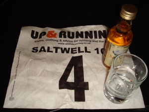 Run number, minature whisky and glass tumbler