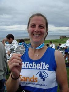 Me holding my Great North Run 2010 medal