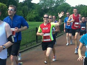 Me waving and running on the Sunderland City 10k