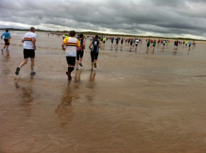 Runners head out over the beach at Alnmouth
