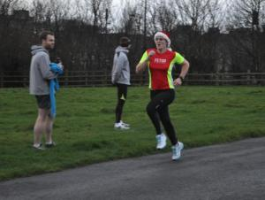 Me running at the Christmas Eve parkrun