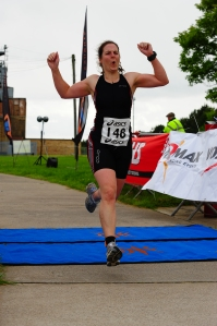 me crossing the finish line at the QE2 sprint triathlon