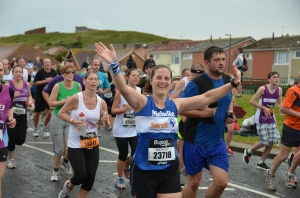 Me waving at the camera on the last mile of the Great North Run 2012