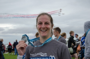 Me at the finish of the Great North Run 2012 with T-shirt, medal and Red Arrows fly past