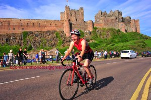 Me on my bike with Bamburgh castle in the background