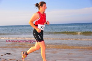 Running on the beach at Bamburgh - photo Bob Marshal