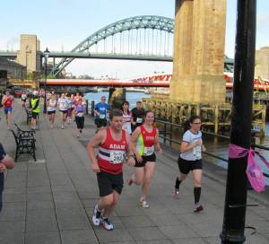 Running along beside the Tyne Bridge