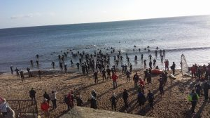 Triathletes enter the water