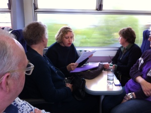 Fiona Thompson reading on a train at the luanch of 26 Under A Northern Sky