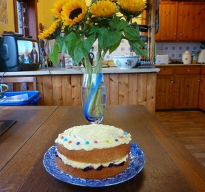 Cake and flowers on a table